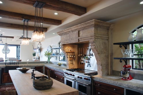antique-stone-mantle-in-kitchen-foundation-blocks-as-countetops-open-space-architecture-1