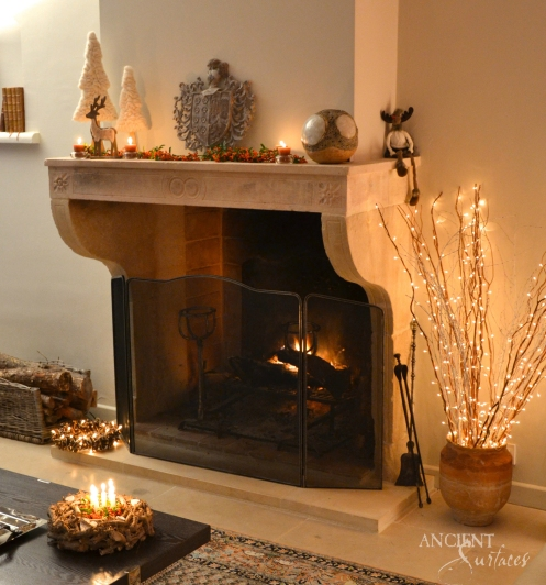 antique-french-farmhouse-limestone-fireplace-during-christmas-019